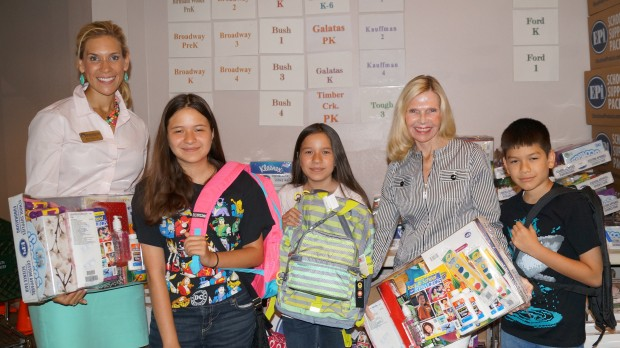 Pictured left to right during the 2014 Kits4Kidz school supply distribution are Missy Herndon, Director of Programs and Services for Interfaith of The Woodlands, Samantha Amaya, Tiffani Amaya, Dr. Ann Snyder, President and CEO of Interfaith of The Woodlands, and Rafael Amaya.  Samantha and Tiffani are students at York Junior High School and Rafael will start fourth grade at Snyder Elementary.