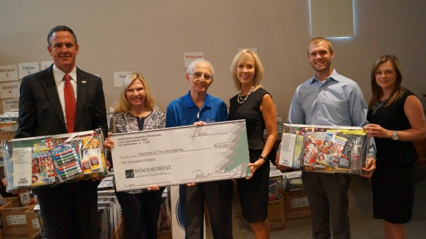 Pictured left to right are Dr. Don Stockton, Superintendent of Schools for CISD, Dr. Ann Snyder, President & CEO of Interfaith of The Woodlands; David Gottlieb; Kim Marling, Executive Director of the Woodforest Charitable Foundation; Charlie Marling and Amy Hegemeyer.  The Woodforest Charitable Foundation is a sponsor of Interfaith's Kits4Kidz school supply program.