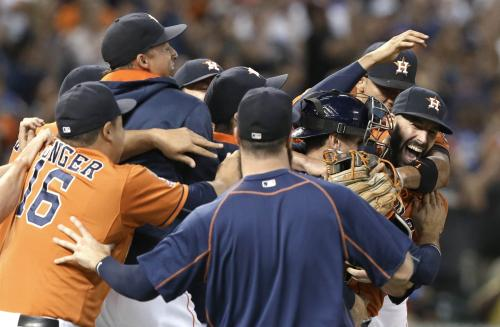 Houston Astros starting pitcher Mike Fiers, right, is mobbed by teammates after his no-hitter against the Los Angeles Dodgers in a baseball game Friday, Aug. 21, 2015, in Houston. The Astros won 3-0. (AP Photo/Pat Sullivan)