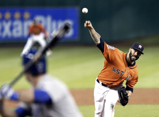 Houston Astros' Mike Fiers delivers a pitch to Los Angeles Dodgers' Chase Utley during the sixth inning of a baseball game Friday, Aug. 21, 2015, in Houston. (AP Photo/Pat Sullivan)