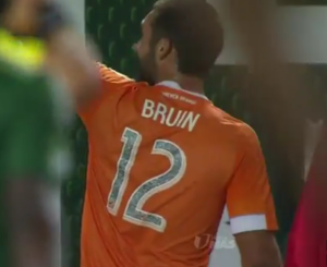 Will Bruin celebrating his goal in front of the Timbers Army