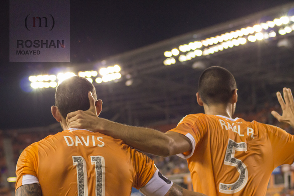Raul Rodriguez celebrating his goal with brad Davis who assisted