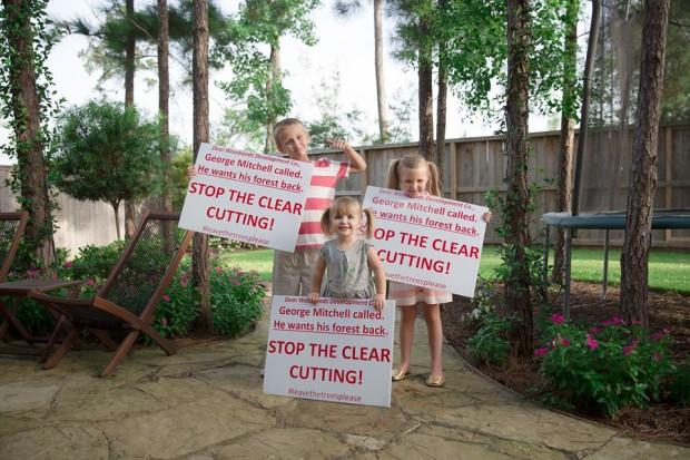 Matthew Burton's Children holding petition signs