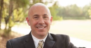 John Brown to file for The Woodlands Township