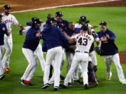 Houston Astros players celebrate after Game 7 of baseball's American League Championship Series against the New York Yankees Saturday, Oct. 21, 2017, in Houston. The Astros won 4-0 to win the series. (AP Photo/Charlie Riedel)